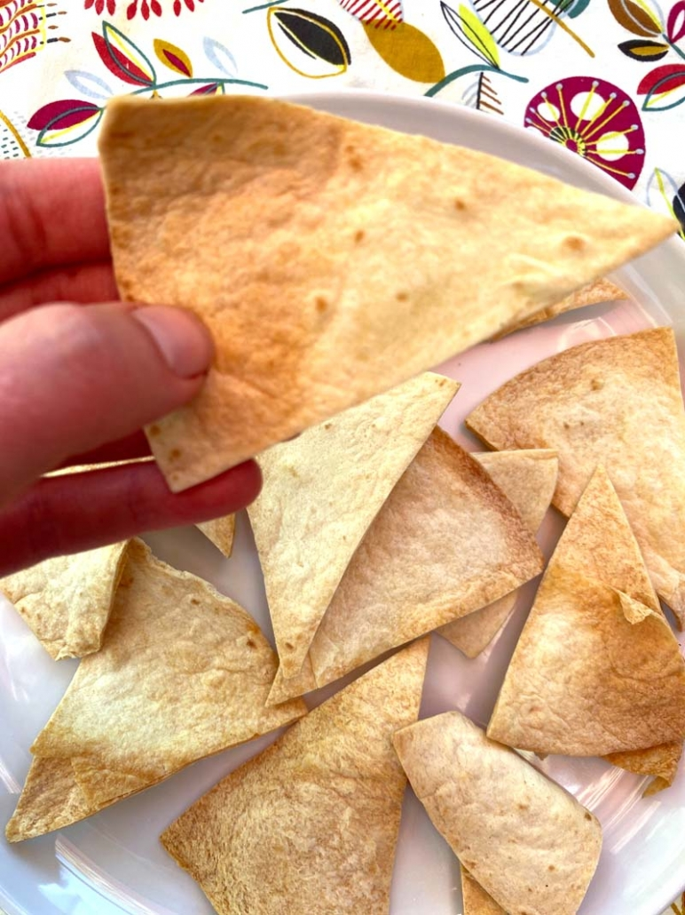 Holding a homemade tortilla chip