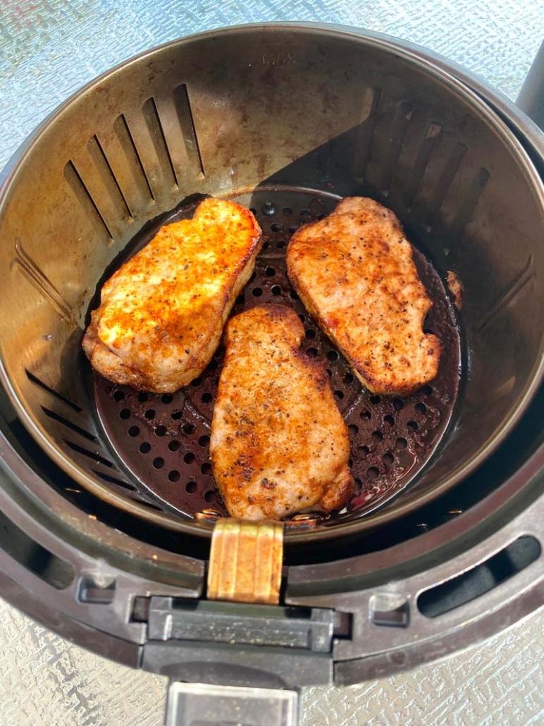 3 cooked boneless pork chops in an air fryer