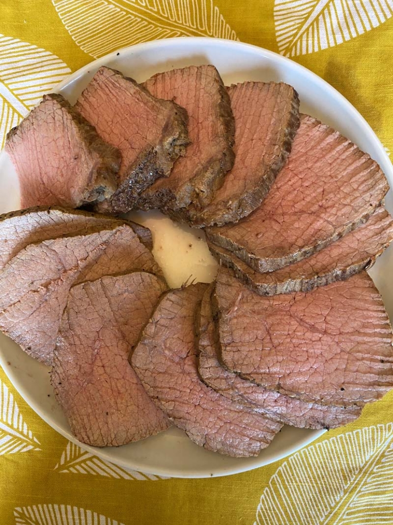 Instant Pot Eye of A Round Round on a plate ready to serve