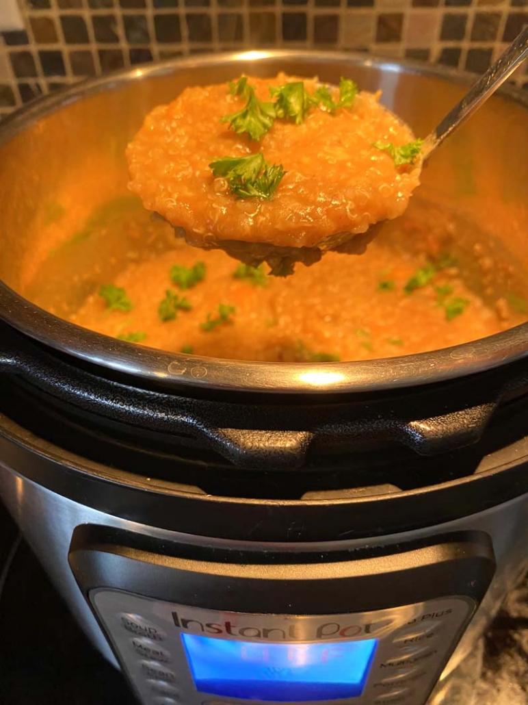 A ladle of Instant Pot Lentil Quinoa Soup