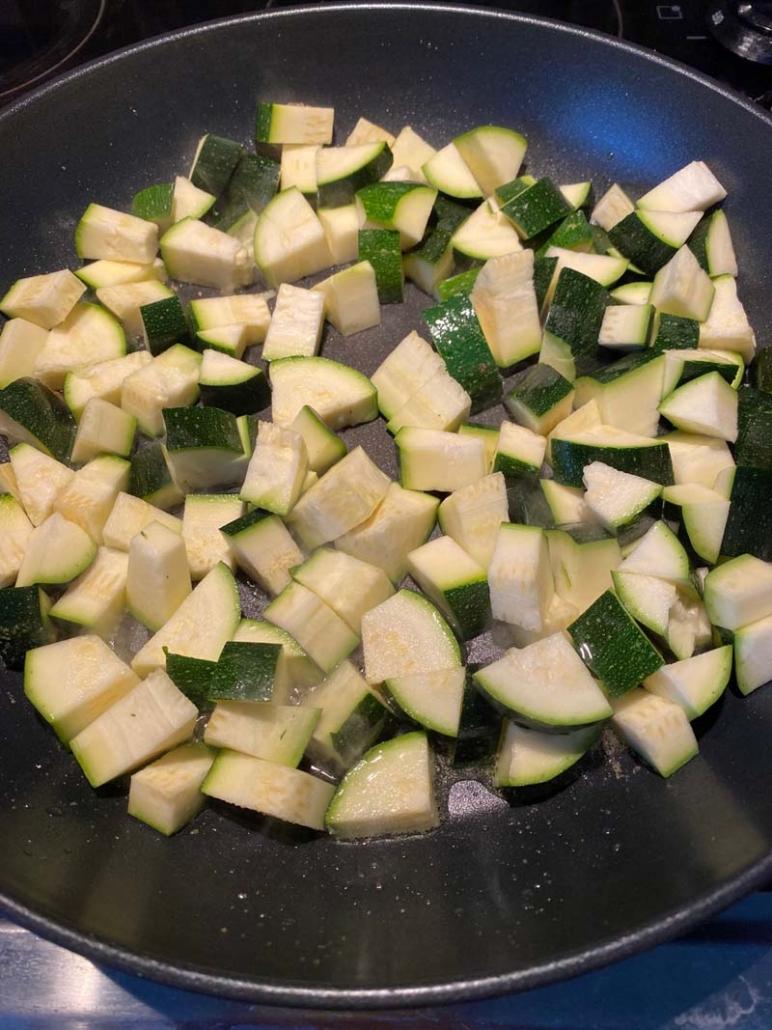 raw chopped zucchini in a pan