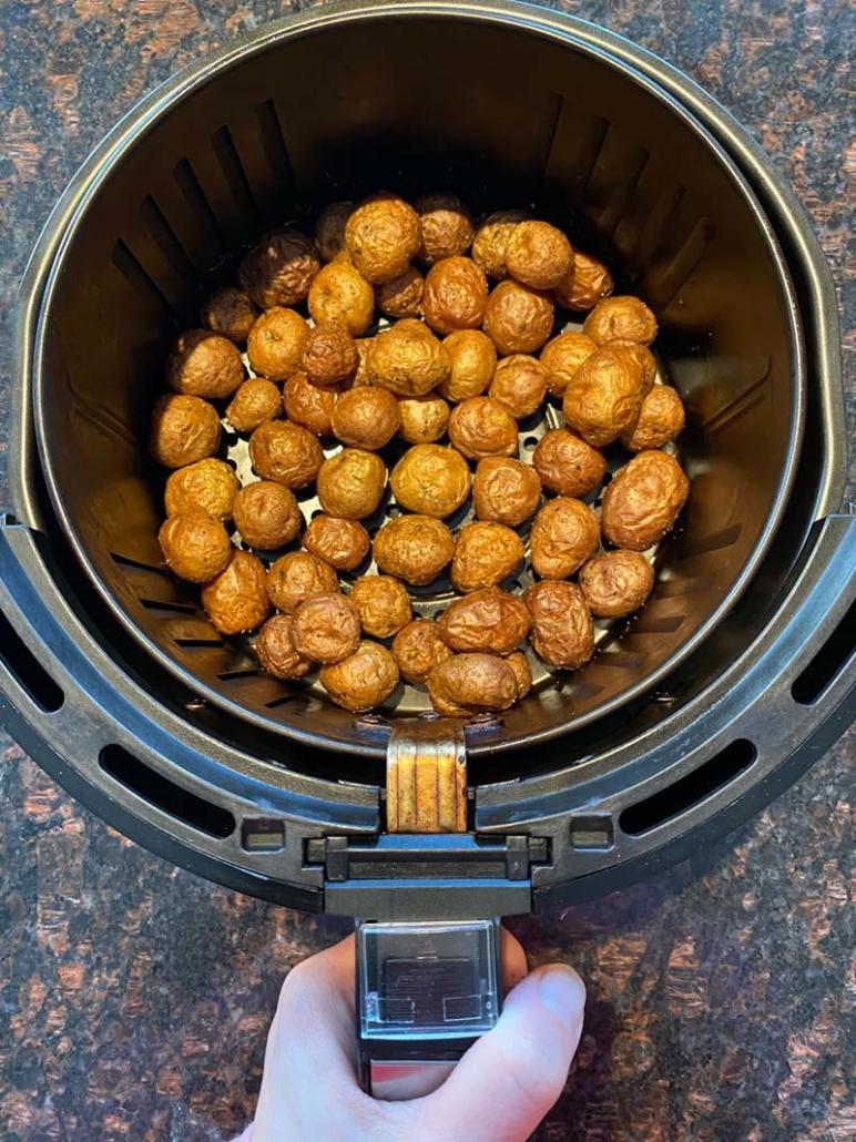 baby potatoes in an air fryer basket