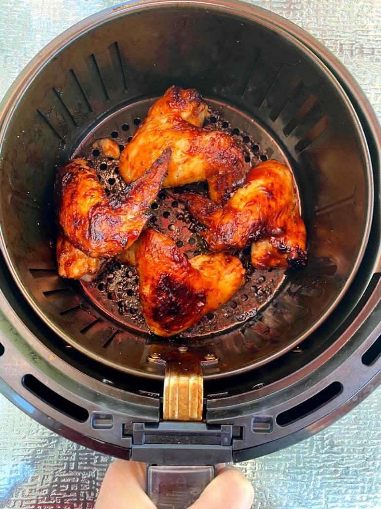 cooking chicken wings in an air fryer basket