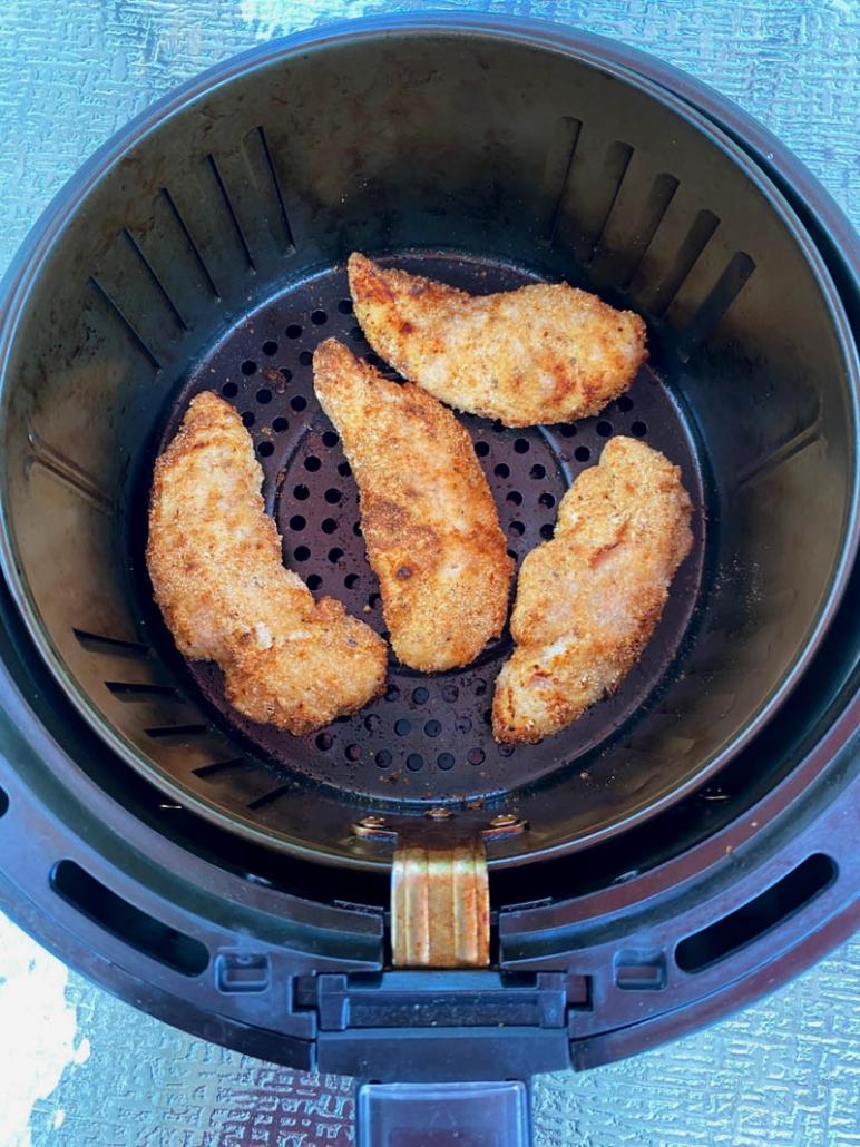 crispy air fried chicken tenders in the air fryer basket