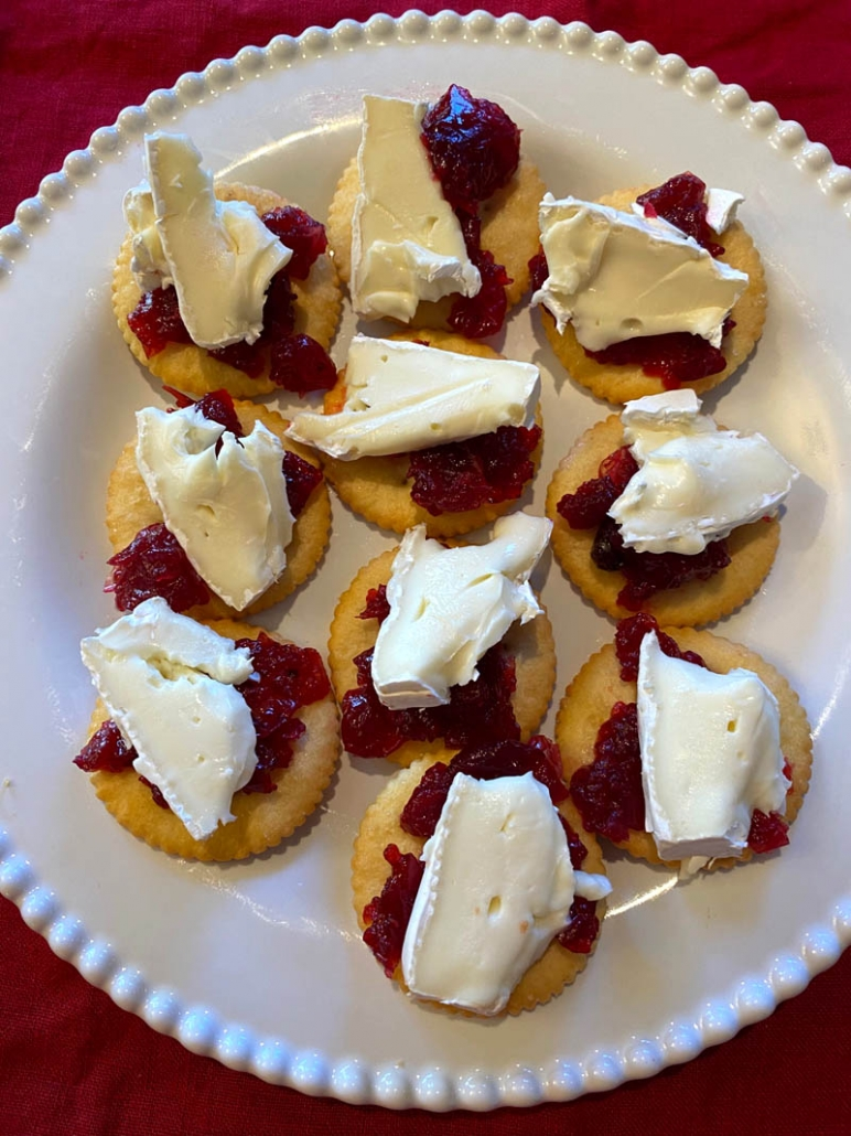 cranberry cheese bites on a white plate