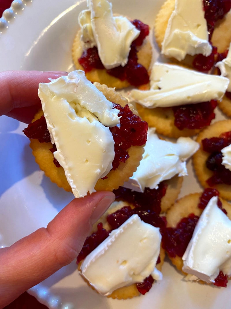 brie cheese and cranberry on a butter cracker