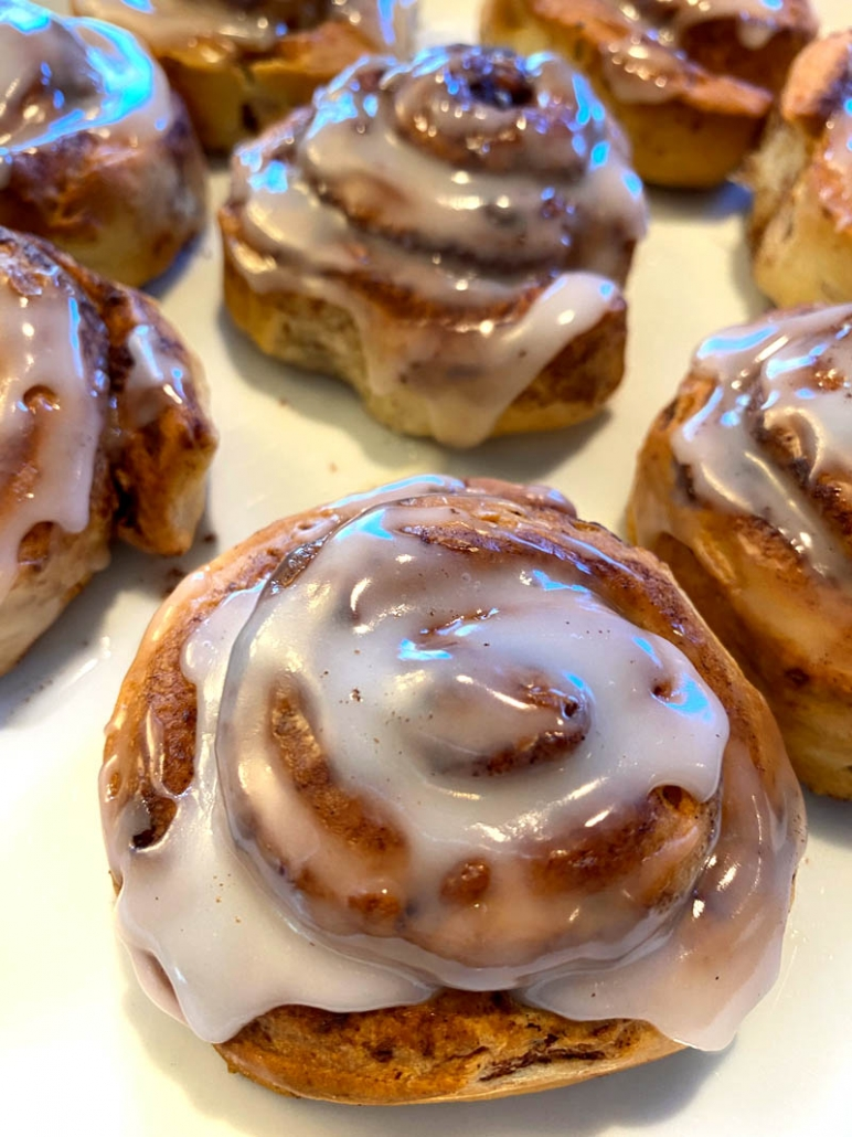 homemade cinnamon rolls topped with icing