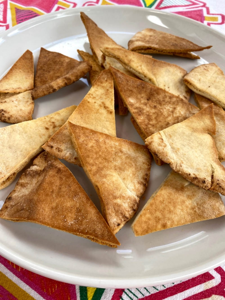 a plate full of pita chips