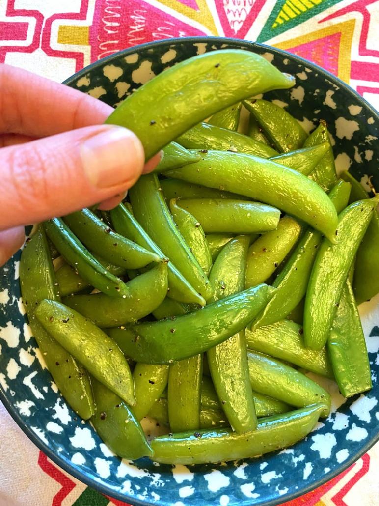 eating seasoned snap peas