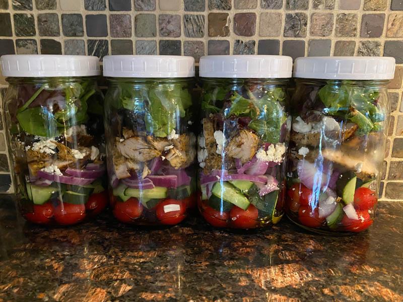 greek chicken salad recipe stored in mason jars