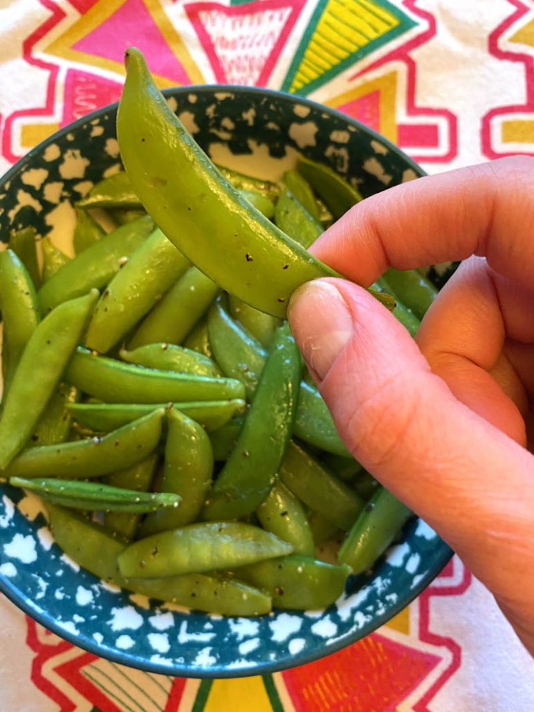 eating a steamed sugar snap pea