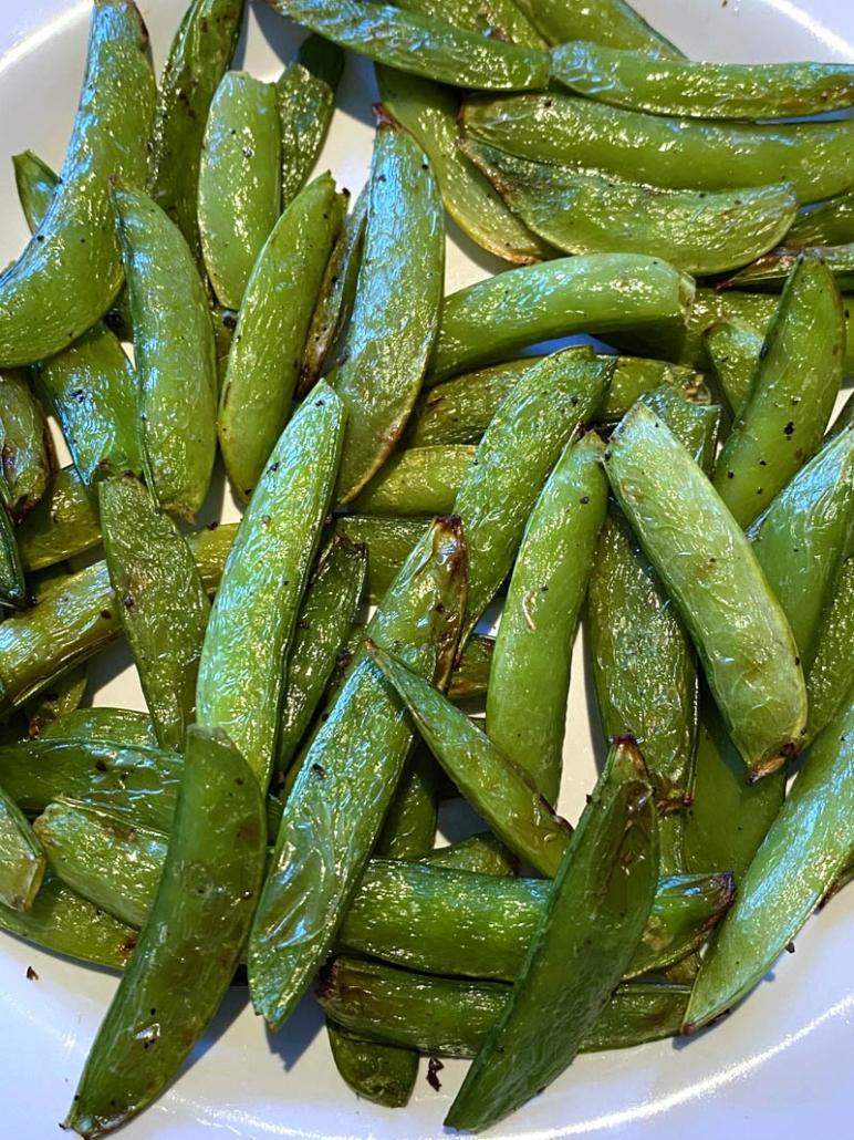 sugar snap peas on a white plate