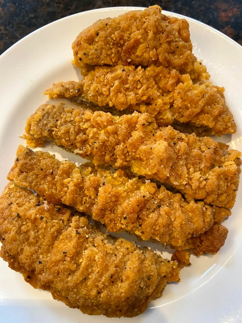 sliced country fried steak on a plate