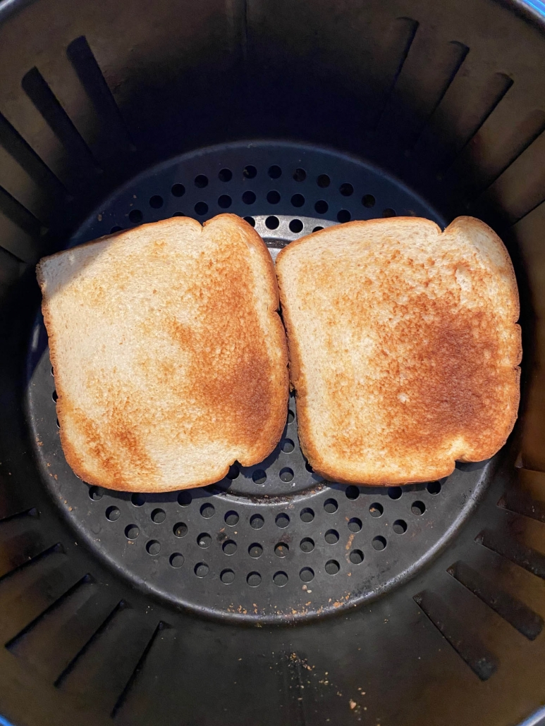 2 pieces of toast in air fryer basket