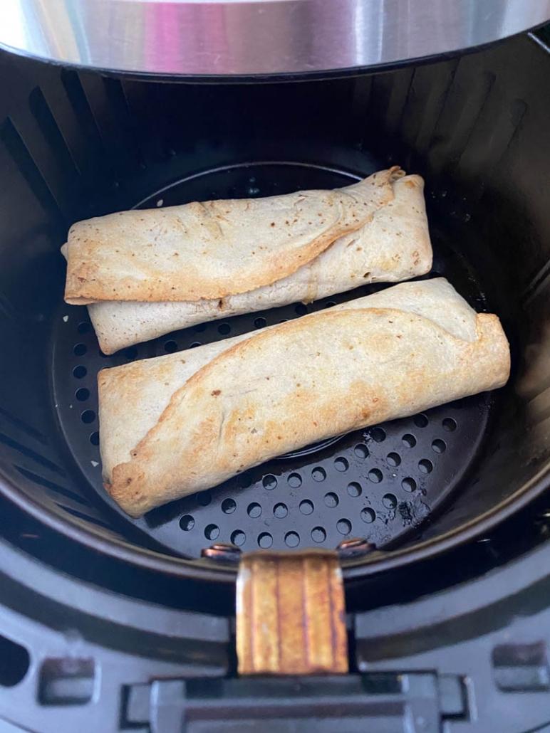 2 chicken burritos on air fryer basket