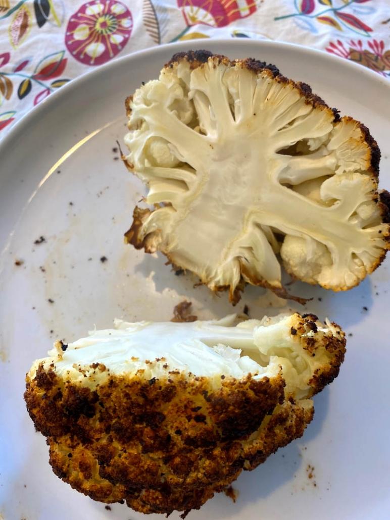 A roasted cauliflower cut in half