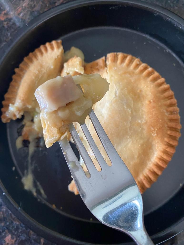 taking a bite of chicken pot pie