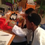 Sons playing with Crayola Color Maker
