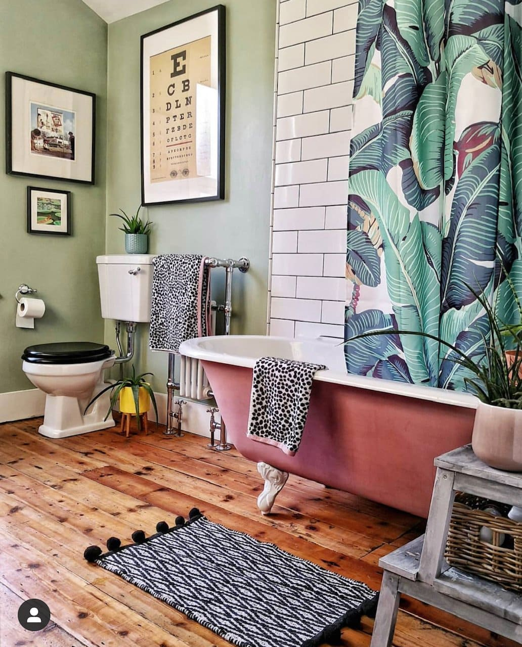 pink bath, botanical print, green walls, wooden floorboard