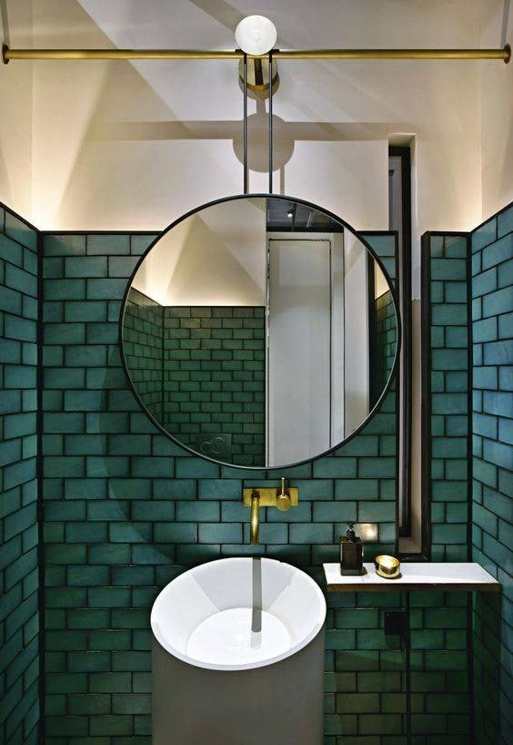green tiles, large mirror, black grout, bathroom