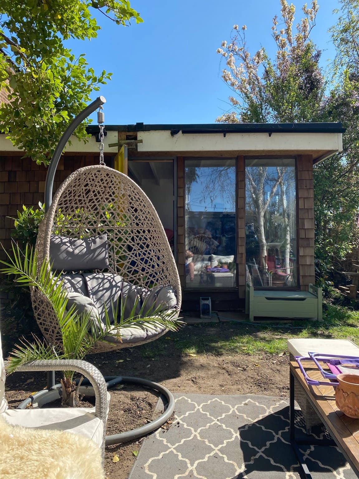 garden shed hanging chair blue sky