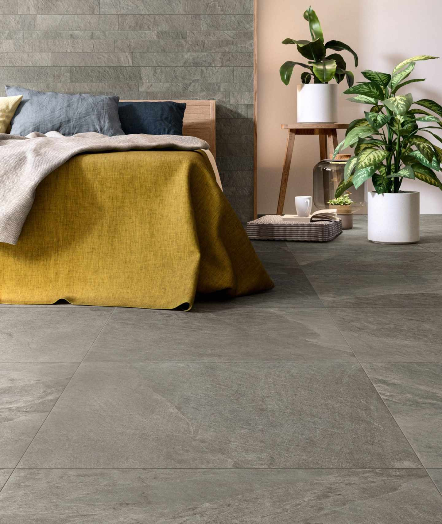 yellow throw in the bedroom with grey slate like tiles on the floor