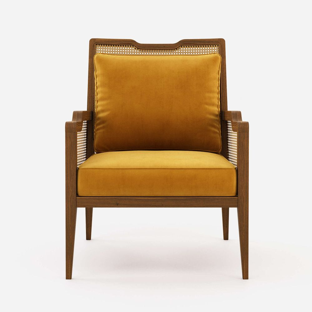 gold upholstered chair with rattan backs and arms