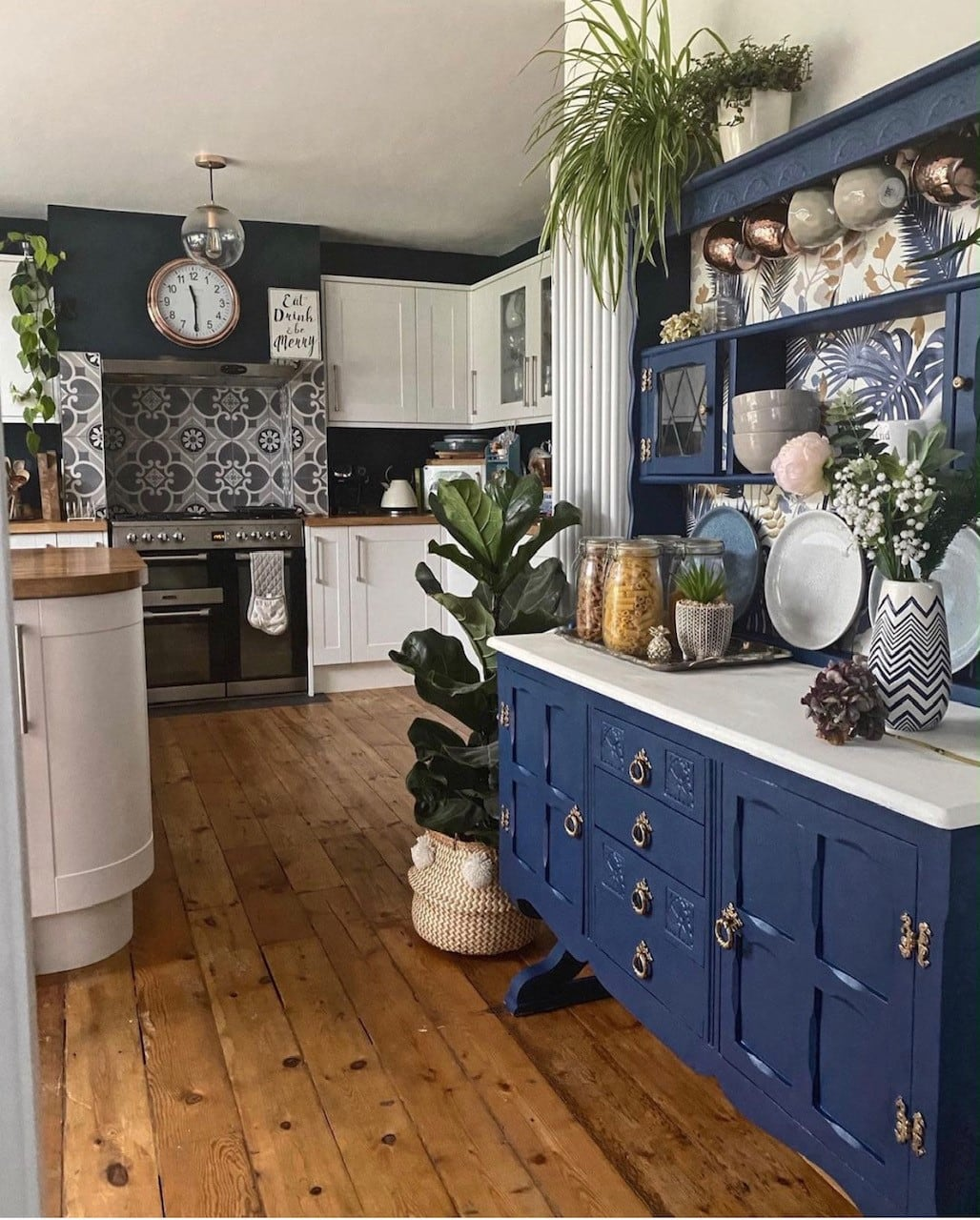 upcycled welsh dresser painted in dulux sapphire salute in the kitchen with howdens units and wooden floorboards