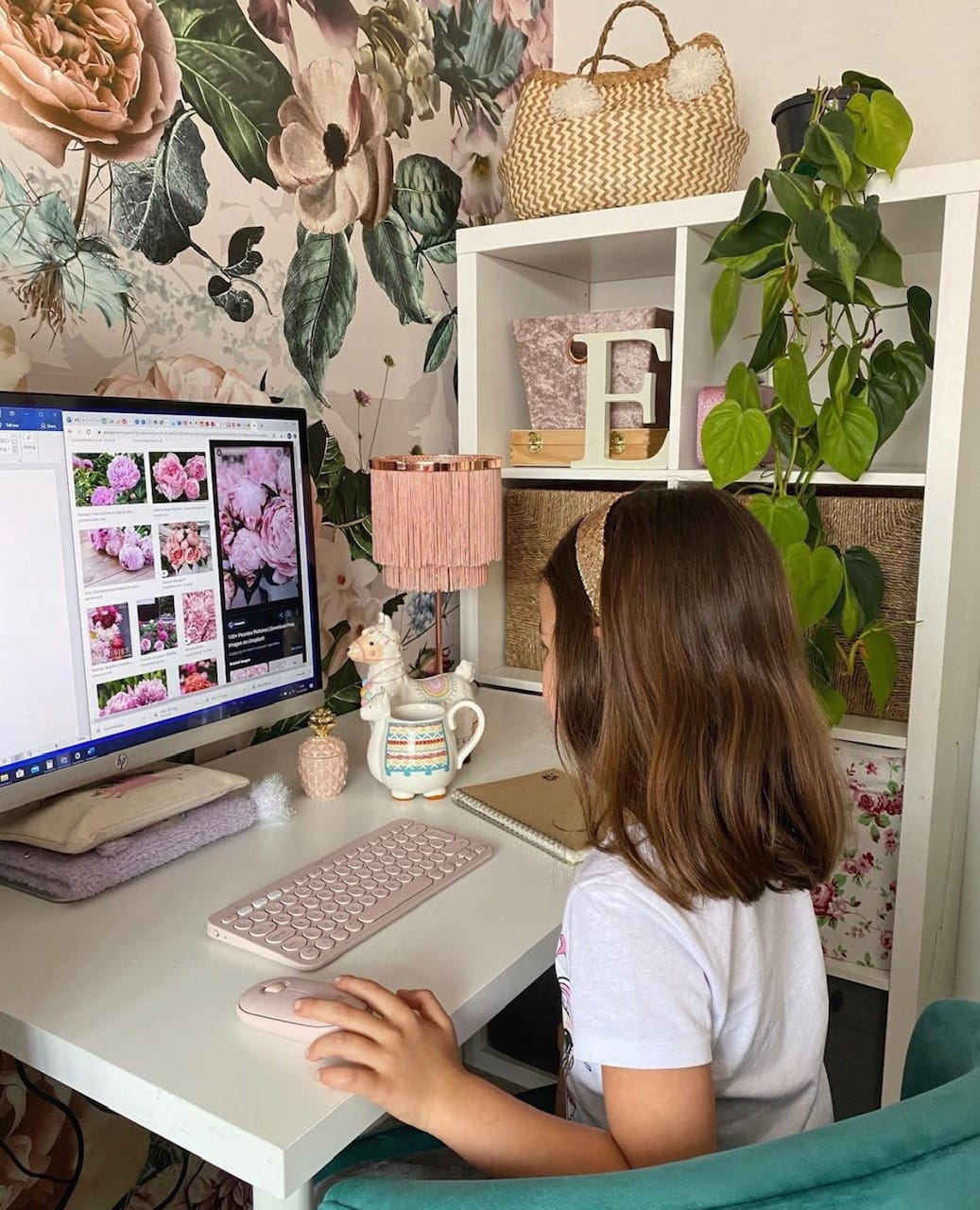 girls bedroom desk with floral wallpaper and fringed lamp