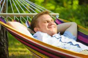 Young man sleeping in a hammock