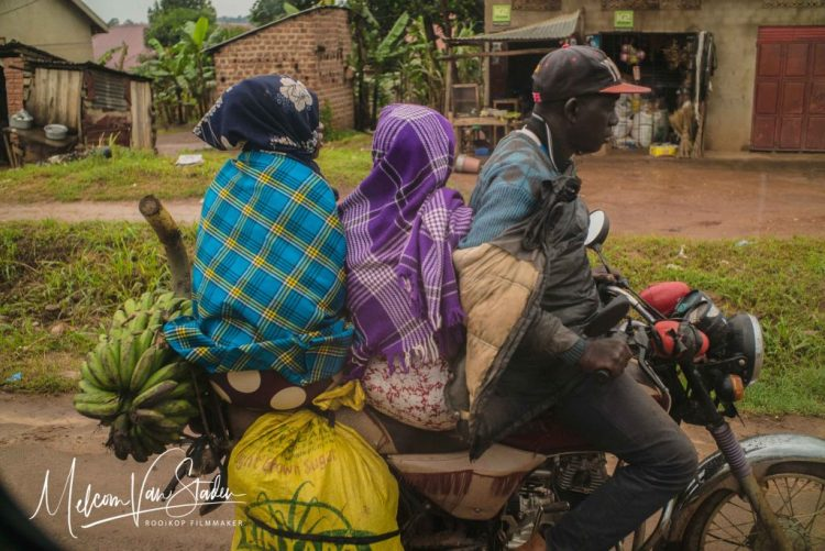 Transporting people and their goods in Uganda.