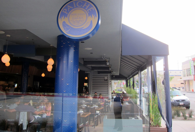 Exterior of Chef Ricardo Zarate's Paiche LA Restaurant featuring hand painted blue and gold column by Melissa Judson.