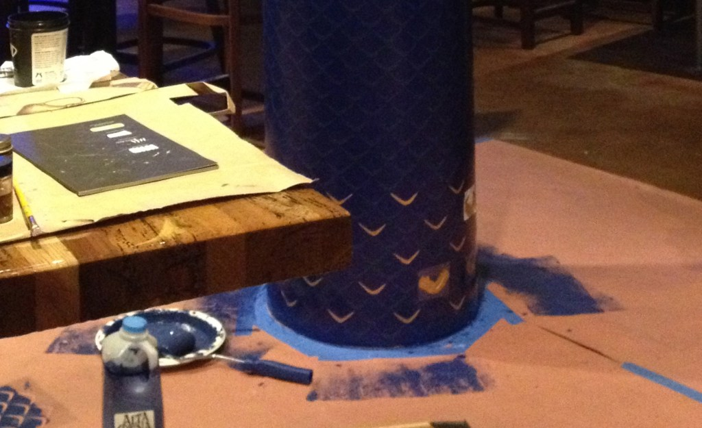 Gold leafing process of Melissa Judson's hand-painted column murals at Chef Ricardo Zarate's Paiche LA Restaurant.