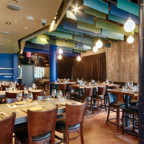 Interior of Chef Ricardo Zarate's Paiche LA Restaurant, custom column mural by Melissa Judson.