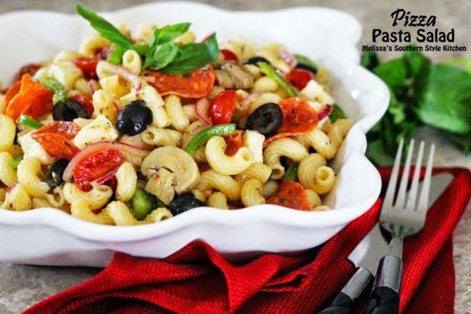 Pizza Pasta Salad with a knife and fork in a bowl
