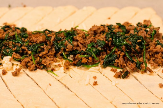 Demonstration of how to assemble Italian Sausage Spinach And Havarti Crescent Braid