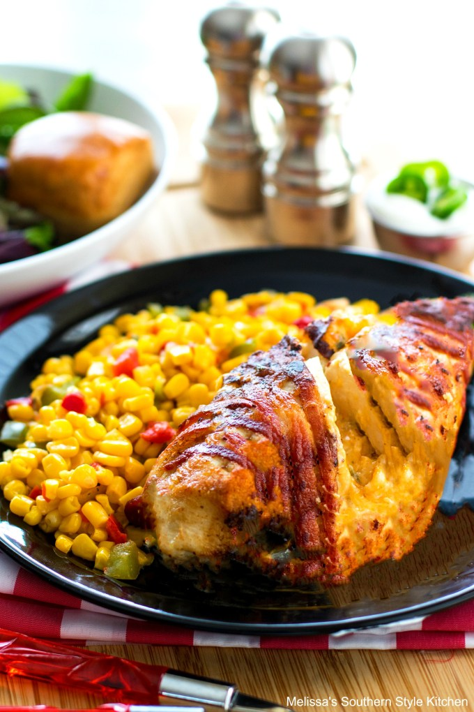 Jalapeno popper chicken on a plate with corn and salad
