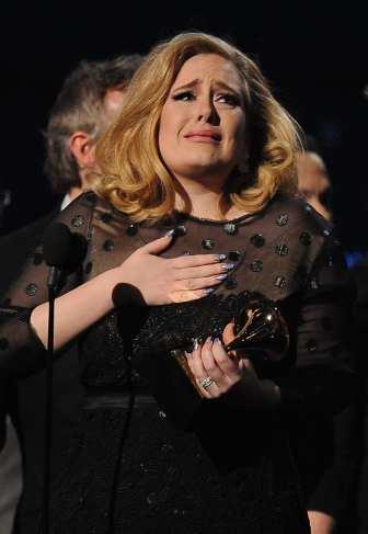 Adele Emozionata ritira il Grammy | © ROBYN BECK/AFP/Getty Images