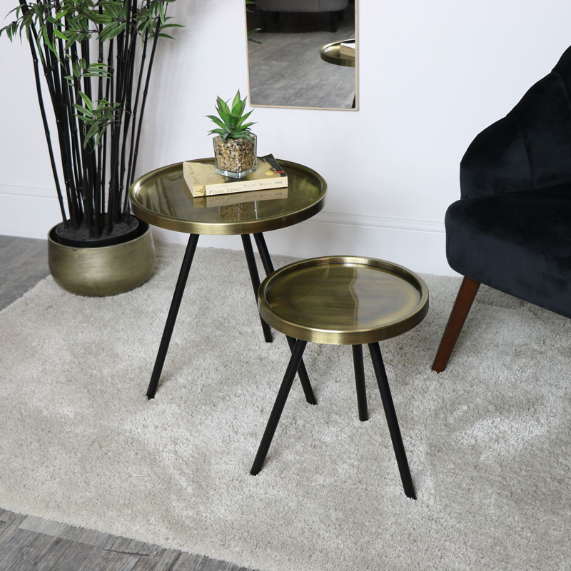 pair of black gold round side tables