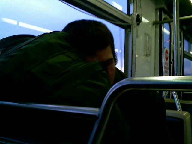 cap'n sleeping on the bus
