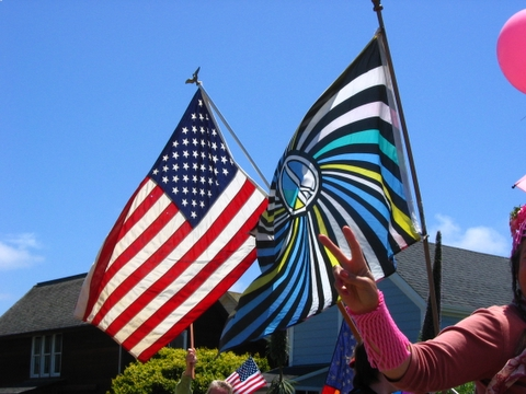 intertwined american and peace flags