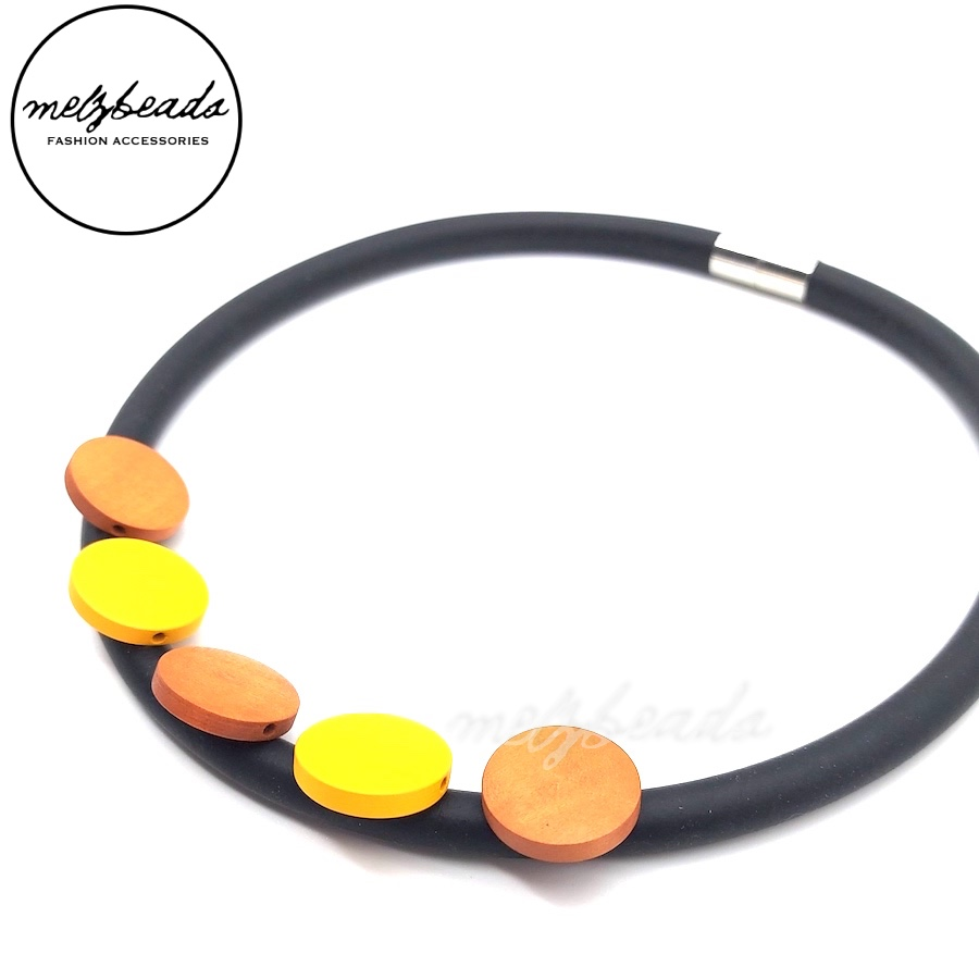 Stylish choker necklace made with rubber cord and small wooden disks