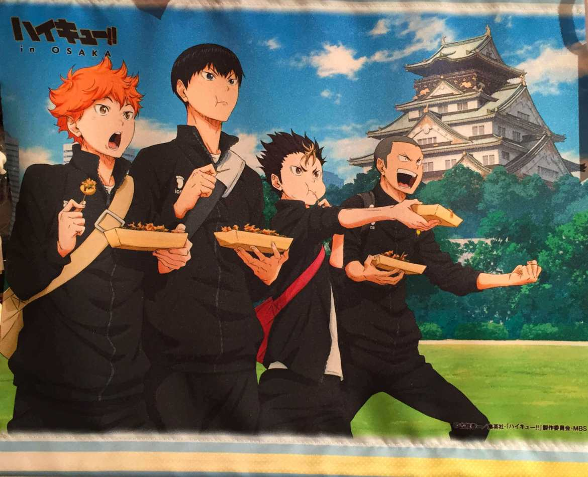Anime characters posing with takoyaki in front of Osaka Castle