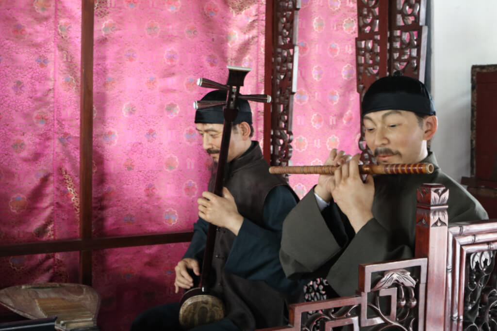 Traditional Flute Player in Zhouzhuang
