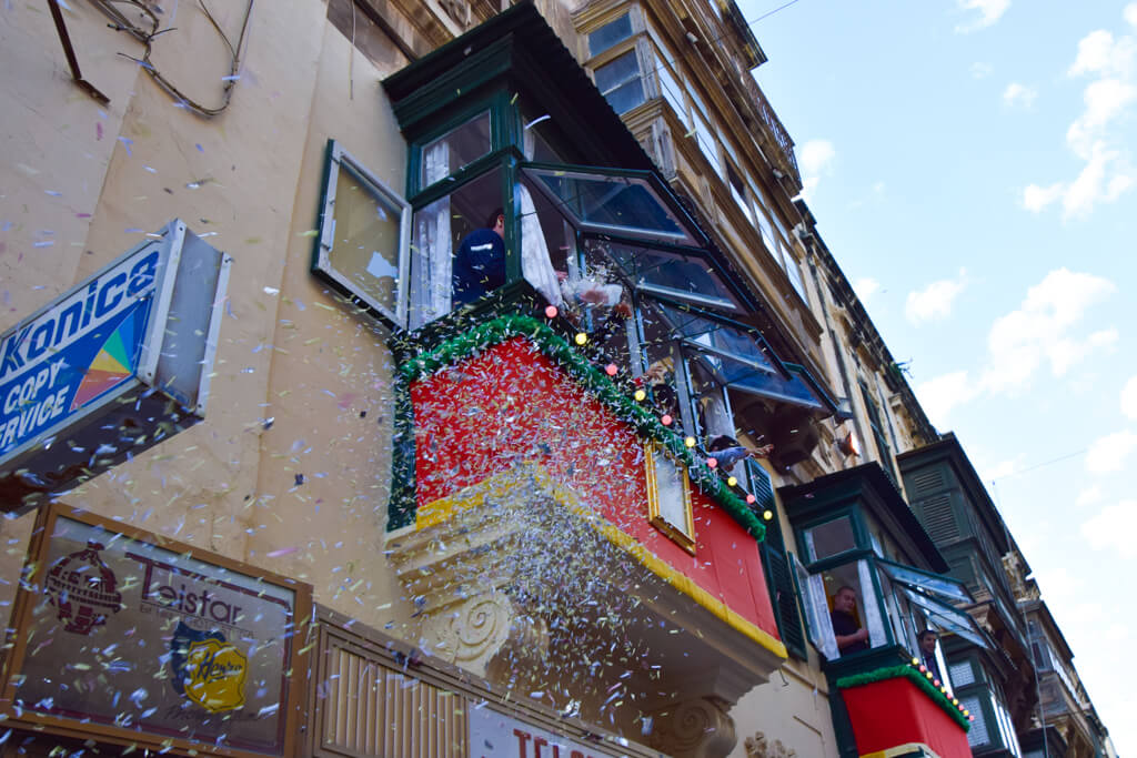 Children throwing confetti on Easter Sunday in Malta