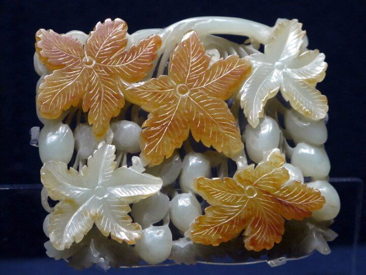 A white and orange floral artifact