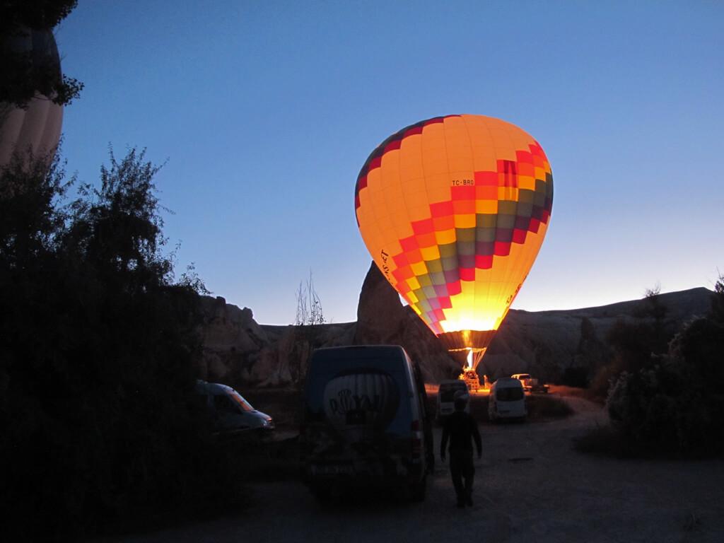 Preparing hot air balloons for takeoff in Cappadocia