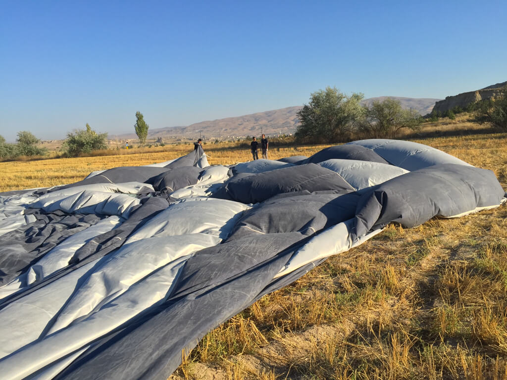 Crew deflates the balloon after a flight in Cappadocia