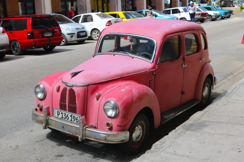 A pink vintage car in Havana, Cuba