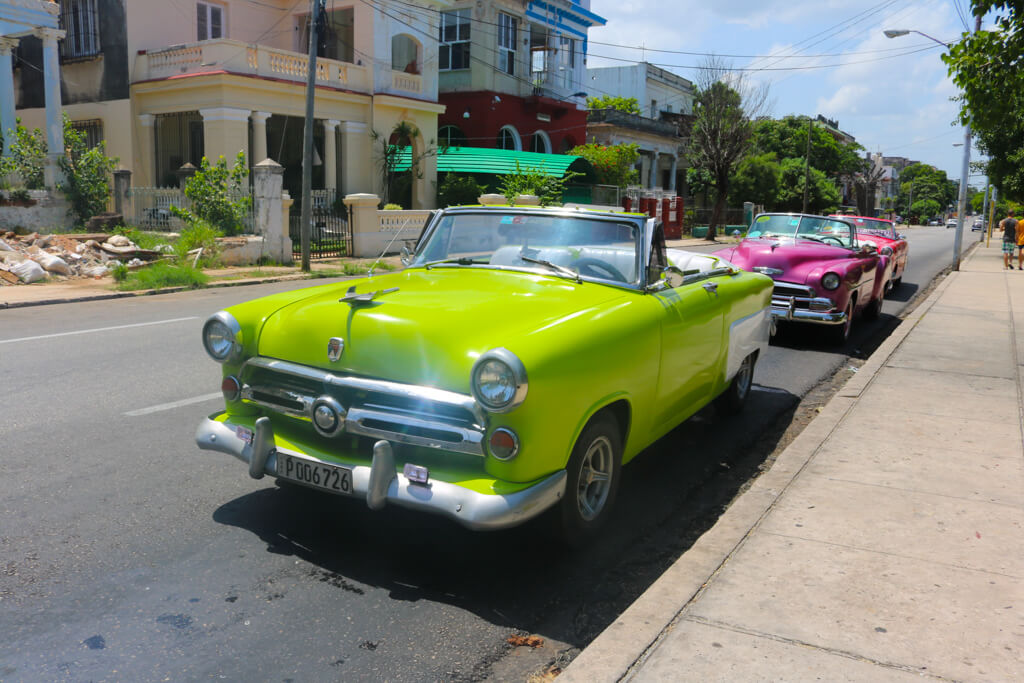 A bright green classic car in Havana, Cuba